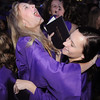 Nicole Roby, left, and Maggie Jurkiewicz celebrate after Wednesday's 85th annual Holy Family High School graduation at Holy Family.<br /> May 19, 2010<br /> Staff photo/ David R. Jennings