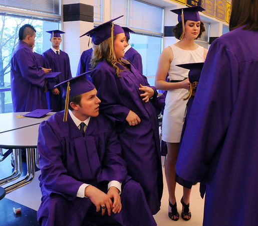 Sophie Messaro, center, leans on Jan Reuter while waiting with Katy Biette for Wednesday's 85th annual Holy Family High School graduation at Holy Family.<br /> May 19, 2010<br /> Staff photo/ David R. Jennings
