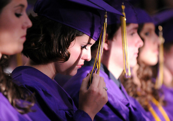 Katy Biette twirls her tassel during Wednesday's 85th annual Holy Family High School graduation at Holy Family.<br /> May 19, 2010<br /> Staff photo/ David R. Jennings