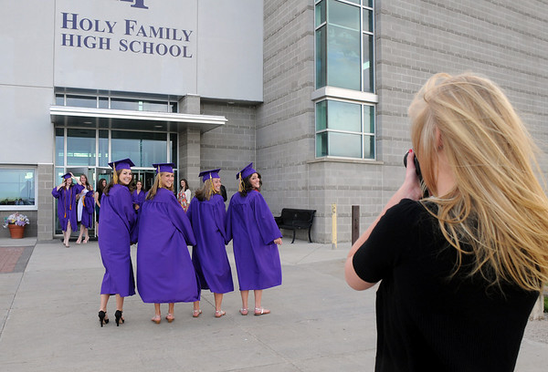 A group of graduates pose for pictures in front of the school before Wednesday's 85th annual Holy Family HIgh School graduation at Holy Family.<br /> May 19, 2010<br /> Staff photo/ David R. Jennings