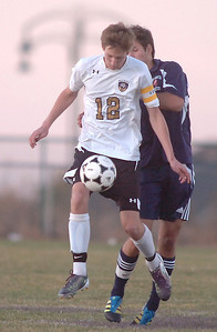 Holy Family's Erik Celmer takes control of the ball from Kent Denver's Austin Hughes during Thursday's game at Michael G. Gabreal Stadium. October 13, 2011 staff photo/ David R. Jennings