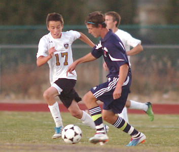 Holy Family's Patrick Borer fights for control of the ball against Kent Denver's Cole Evans during Thursday's game at Michael G. Gabreal Stadium. October 13, 2011 staff photo/ David R. Jennings