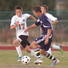 Holy Family's Patrick Borer fights for control of the ball against Kent Denver's Cole Evans during Thursday's game at Michael G. Gabreal Stadium.<br /> October 13, 2011<br /> staff photo/ David R. Jennings