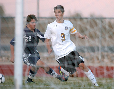 Holy Family's Alexander Toderica takes a shot on goal past Marcus Stears  during Thursday's game at Michael G. Gabreal Stadium. October 13, 2011 staff photo/ David R. Jennings