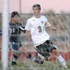 Holy Family's Alexander Toderica takes a shot on goal past Marcus Stears  during Thursday's game at Michael G. Gabreal Stadium.<br /> October 13, 2011<br /> staff photo/ David R. Jennings