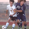 Holy Family's Preston Arguello fights for control of the ball against Kent Denver's Marcus Stears during Thursday's game at Michael G. Gabreal Stadium.<br /> October 13, 2011<br /> staff photo/ David R. Jennings
