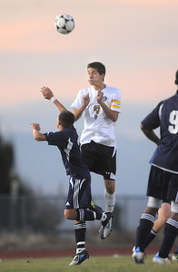 Holy Family's Alexander Toderica does a header over Kent Denver's Matt Olson during Thursday's game at Michael G. Gabreal Stadium. October 13, 2011 staff photo/ David R. Jennings