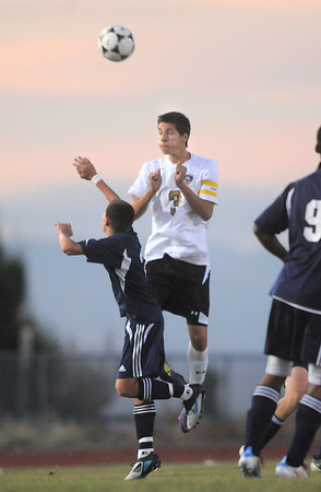 Holy Family's Alexander Toderica does a header over Kent Denver's Matt Olson during Thursday's game at Michael G. Gabreal Stadium.<br /> October 13, 2011<br /> staff photo/ David R. Jennings