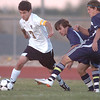 Holy Family's Preston Arguello takes control of the ball from Kent Denver's Marcus Stears and Cole Evans during Thursday's game at Michael G. Gabreal Stadium.<br /> October 13, 2011<br /> staff photo/ David R. Jennings