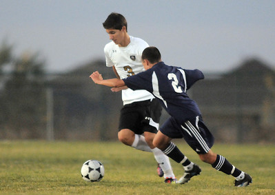 Holy Family's Alexander Toderica moves the ball past Kent Denver's Greer Solarte during Thursday's game at Michael G. Gabreal Stadium. October 13, 2011 staff photo/ David R. Jennings