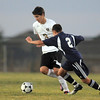 Holy Family's Alexander Toderica moves the ball past Kent Denver's Greer Solarte during Thursday's game at Michael G. Gabreal Stadium.<br /> October 13, 2011<br /> staff photo/ David R. Jennings