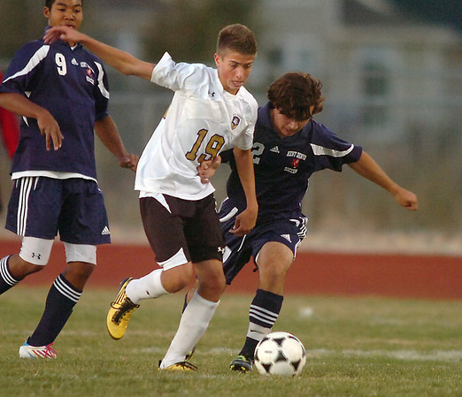 Holy Family's Nate Dalton fights for control of the ball with Kent Denver's Marcus Stears  during Thursday's game at Michael G. Gabreal Stadium.<br /> October 13, 2011<br /> staff photo/ David R. Jennings