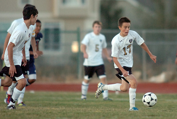 Holy Family's Patrick Borer dribbles the ball downfield against Kent Denver during Thursday's game at Michael G. Gabreal Stadium.<br /> October 13, 2011<br /> staff photo/ David R. Jennings