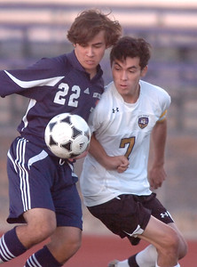 Holy Family's Preston Arguello fights for control of the ball against Kent Denver's Marcus Stears  during Thursday's game at Michael G. Gabreal Stadium. October 13, 2011 staff photo/ David R. Jennings