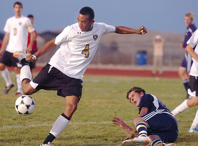 Holy Family's Nick Rhoden kicks a shot on goal against Kent Denver  during Thursday's game at Michael G. Gabreal Stadium. October 13, 2011 staff photo/ David R. Jennings