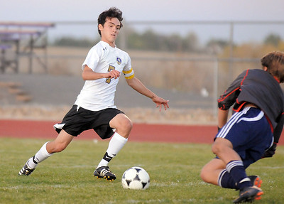 Holy Family's Preston Arguello kicks a shot on goal against Kent Denver's goalie Sam Buck during Thursday's game at Michael G. Gabreal Stadium. October 13, 2011 staff photo/ David R. Jennings