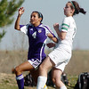 Tarah Neam, Holy Family, does a header past Andrea Worchester, Bishop Machebeuf, during Wednesday's game at Machebeuf.<br /> <br /> April 14, 2010<br /> Staff photo/David R. Jennings