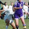 Kristina Burk, Holy Family, fights for control of the ball with Kristina Lech, Bishop Machebeuf, during Wednesday's game at Machebeuf.<br /> <br /> April 14, 2010<br /> Staff photo/David R. Jennings