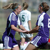 Holy Family's Kristina Burk, left, celebrates her goal against Bishop Machebeuf with teammate Ashley Burk during Wednesday's game at Machebeuf.<br /> <br /> April 14, 2010<br /> Staff photo/David R. Jennings