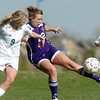 Amy Baumberger, Holy Family, kicks the ball away from Theresa Hegarty, Bishop Machebeuf, during Wednesday's game at Machebeuf.<br /> <br /> April 14, 2010<br /> Staff photo/David R. Jennings
