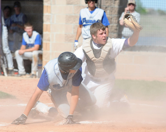 Holy Family's catcher Chris McManus tags out Peak to Peak's Garrett Bride at home plate during Friday's game at Holy Family.<br /> May 04, 2012 <br /> staff photo/ David R. Jennings