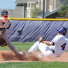 Holy Family's Garrett West slides to second base against Peak to Peak's Mitchell Ward during Friday's game at Holy Family.<br /> May 04, 2012 <br /> staff photo/ David R. Jennings