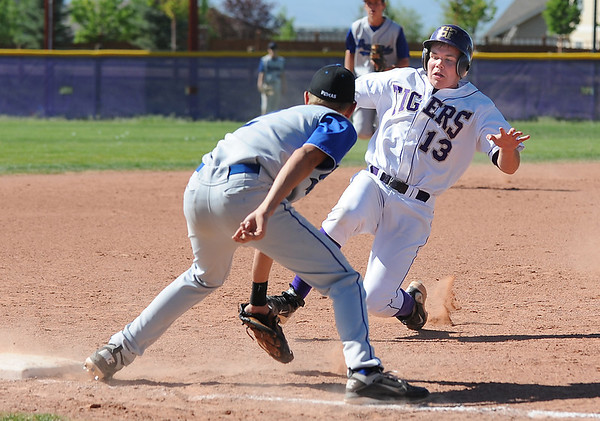 Holy Family's Jacob Tinnon slides to third base against Peak to Peak's Issac Friesen during Friday's game at Holy Family.<br /> May 04, 2012 <br /> staff photo/ David R. Jennings