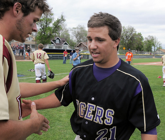 Rob McCandlish, Holy Family, right, shakes the hand of David Bote, Faith Christian after the state 3A championship game at Jackson Field in Greeley on Saturday.<br /> May 28, 2011<br /> staff photo/David R. Jennings