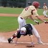 Holy Family's first baseman Garrett West collides with Faith Christian's Nolan Beasley during the state 3A championship game at Jackson Field in Greeley on Saturday.<br /> May 28, 2011<br /> staff photo/David R. Jennings