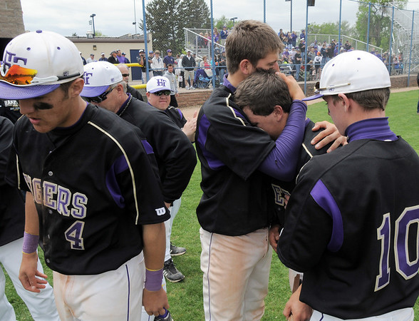 Holy Family's Rob McCandlish is comforted by Kyle Munoz after loosing to Faith Christian during the state 3A championship game at Jackson Field in Greeley on Saturday.<br /> May 28, 2011<br /> staff photo/David R. Jennings