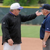 Holy Family's head coach Marc Cowell argues with the first base umpire after a controversial play at first base during the state 3A championship game at Jackson Field in Greeley on Saturday.<br /> May 28, 2011<br /> <br /> May 28, 2011<br /> staff photo/David R. Jennings