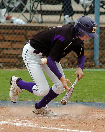 Tom Erb, Holy Family attempts a bunt against Faith Christian during the state 3A championship game at Jackson Field in Greeley on Saturday.<br /> May 28, 2011<br /> staff photo/David R. Jennings
