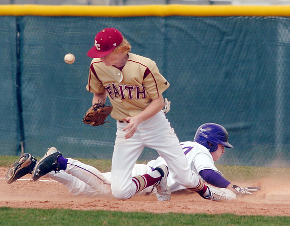 Holy Family's Jay Elliott safley slides to firstbase beating the ball thrown to Faith Christian's Tyler Tucker during Saturday's double header at Holy Family.<br /> April 16, 2011<br /> staff photo/David R. Jennings