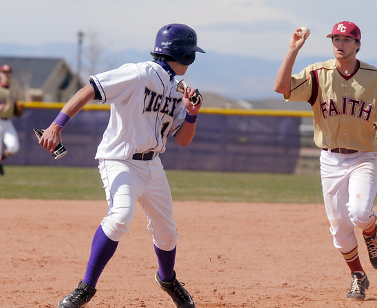 Holy Family's Jay Eliott runs away from Faith Christian's David Bote after being trapped between second and thrid bases during Saturday's double header at Holy Family.<br /> April 16, 2011<br /> staff photo/David R. Jennings