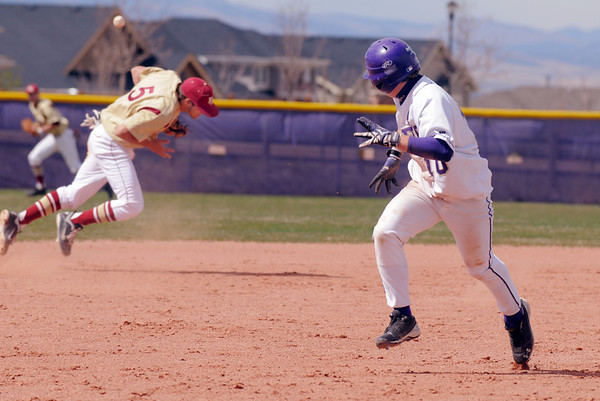 Holy Family's Jay Elliott runs to thirdbase while Faith Christian's David Bote bobbles the ball during Saturday's double header at Holy Family.<br /> April 16, 2011<br /> staff photo/David R. Jennings