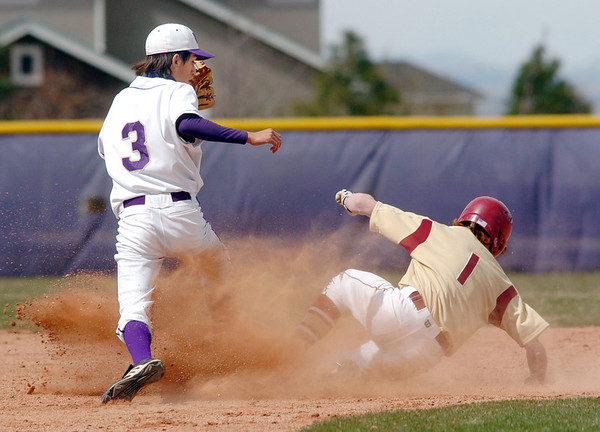 Holy Family's second baseman Louis Simpson beats Faith Christian's Tyler Tucker to second base for an out during Saturday's double header at Holy Family.<br /> April 16, 2011<br /> staff photo/David R. Jennings