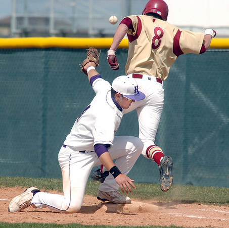 Holy Family's Garrett West tries to tag out Faith Christian's Nolan Beasley at firstbase during Saturday's double header at Holy Family.<br /> April 16, 2011<br /> staff photo/David R. Jennings