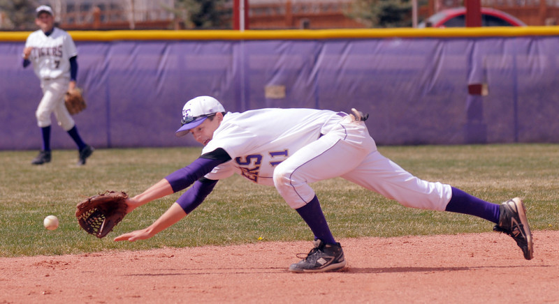 Holy Family's shortstop Devlin Granberg dives for the ball during Saturday's double header against Faith Christian at Holy Family.<br /> April 16, 2011<br /> staff photo/David R. Jennings