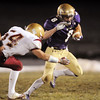 Austin Maul, Holy Family runs away from the tackle attempt by Andy Anderson, Faith Christian, during Friday's game at Mike G. Gabriel Stadium.<br /> October 30, 2009<br /> Staff photo/David R. Jennings