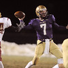 Holy Family's quarterback Joe Sommers throws a pass as Derek McCartney, Faith Christian tries to block the pass during Friday's game at Mike G. Gabriel Stadium.<br /> October 30, 2009<br /> Staff photo/David R. Jennings
