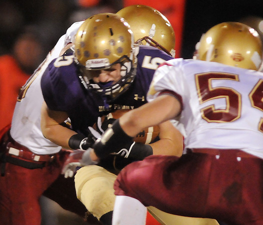 Bryan Murphy, Holy Family tries to break a tackle by Andy Anderson, Faith Christian during Friday's game at Mike G. Gabriel Stadium.<br /> October 30, 2009<br /> Staff photo/David R. Jennings