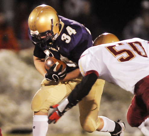 Duncan Yost,  Holy Family, gains yards as Derek Krcil, Faith Christian starts to make a tackle during Friday's game at Mike G. Gabriel Stadium.<br /> October 30, 2009<br /> Staff photo/David R. Jennings