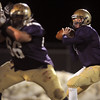 Quarterback Joe Sommers, Holy Family eyes a receiver downfield  during Friday's game against Faith Christian at Mike G. Gabriel Stadium.<br /> October 30, 2009<br /> Staff photo/David R. Jennings