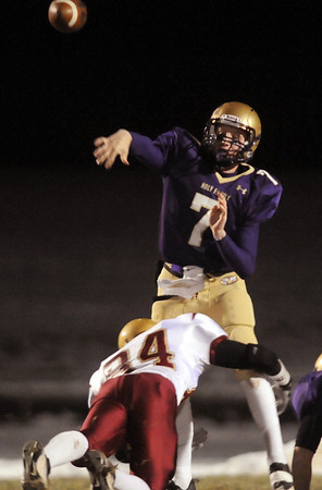 Holy Family's quarterback Joe Sommers throws a pass as Andy Clement, Faith Christian tries to make a tackle during Friday's game at Mike G. Gabriel Stadium.<br /> October 30, 2009<br /> Staff photo/David R. Jennings