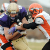 Austin Maul, Holy Family is tackled by Lamar's Ricky Rodgriguez and Darrian Adame during Saturday's game at Mike G. Gabriel Stadium.<br /> <br /> November 14, 2009<br /> Staff photo/David R. Jennings