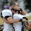 King Medlin, left, and Jackson Wagner, Holy Family, comfort each other after the Tiger's loss to Platte Canyon after Saturday's game at Platte Canyon High.<br /> November 21, 2009<br /> Staff photo/David R. Jennings