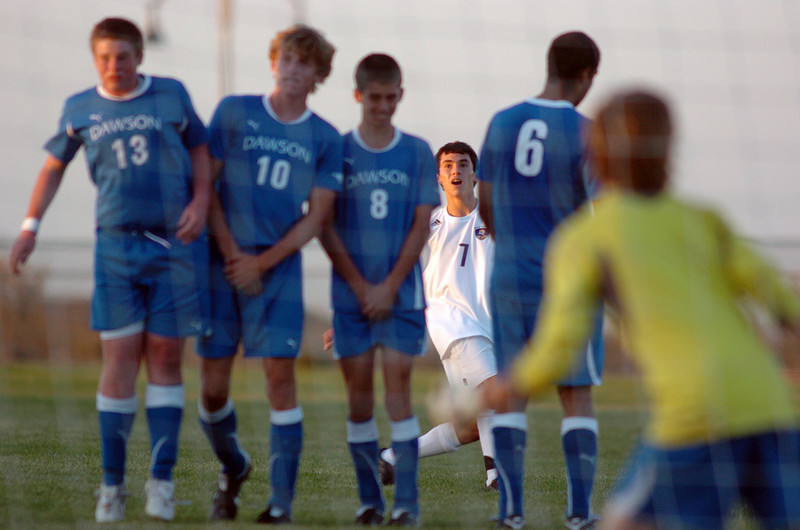 Holy Family's Preston Arguello, looks through a line of Alexander Dawon players after kicking a penalty shot to the goal during Thursday's game at  Mike G. Gabriel Stadium.<br /> <br /> September 30, 2010<br /> staff photo/David R. Jennings