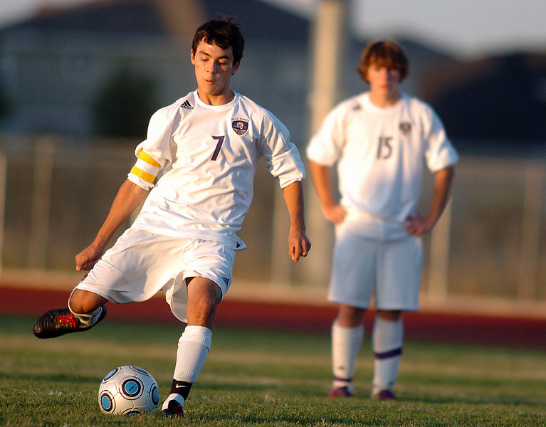 Preston Arguello, Holy Family kicks a penalty shot to score against Alexander Dawon during Thursday's game at  Mike G. Gabriel Stadium.<br /> <br /> September 30, 2010<br /> staff photo/David R. Jennings