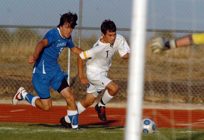 Preston Arguello, Holy Family, fights to make a shot at the goal against Kyle Koenig, Alexander Dawon during Thursday's game at  Mike G. Gabriel Stadium.<br /> <br /> September 30, 2010<br /> staff photo/David R. Jennings