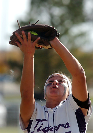 Holy Family's Alejandra Sullivan catches a hit by Berthoud during the state softball tournament at the Aurora Sparts Park on Friday.<br /> October 21, 2011<br /> staff photo/ David R. Jennings